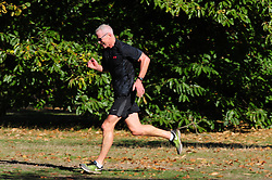 © Licensed to London News Pictures. 09/10/2018<br /> GREENWICH, UK.<br /> A man running round the Park.<br /> People out and about in an autumnal Greenwich Park on a sunny October day in London and the South East with temperatures at 19C with blue sky. <br /> Photo credit: Grant Falvey/LNP