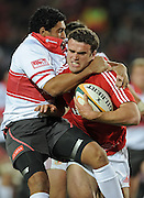 Centre of the British&Irish Lions, Jamie Roberts is tackled around the neck by Shandre Frolick of the Xerox Lions.<br /> Rugby - 090602 - British&Irish Lions v Xerox Lions - Coca-Cola Park - Johannesburg - South Africa. The British Lions won 74-10 scoring 10 tries.<br /> Photographer : Anton de Villiers / SASPA