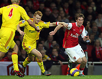 Photo: Paul Thomas.<br /> Arsenal v Liverpool. The Barclays Premiership. 12/11/2006.<br /> <br /> John Arne Riise (C) of Liverpool tries to tackle Alexander Helb.