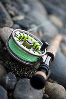Close-up of fly fishing reel and steelhead.
