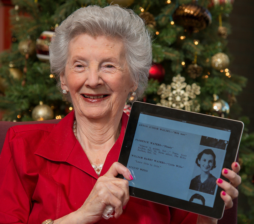 "Florence Waters Schillaci, 95, displays her photo from the 1936 Milby High School yearbook ""The Buffalo"" on a tablet at her home, December 17, 2013. Milby students have been digitizing past copies of the yearbook for a class project."
