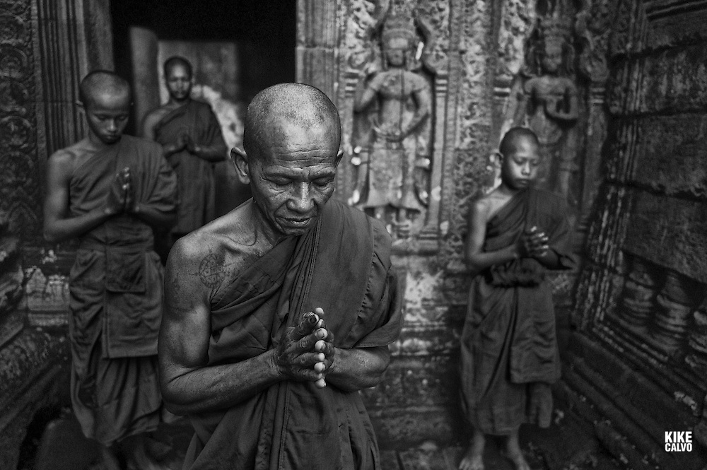 Theravada Buddhists from Phras Ang Tep Monastery at Ta Prohm Jungle Temple (Angkor Complex)   . August 11, 2013. (Kike Calvo via AP Images)