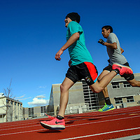 030315       Adron Gardner<br /> <br /> Niles Thomas, left, and Travis Canuto race to the finish on at the end of a 400m sprint during track practice at Miyamura High School Tuesday.