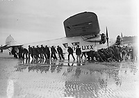 'Faith in Australia' aeroplane being pulled along Portmarnock Strand.27 July 1933.<br /> Flight Lieutenant and owner of the plane was Charles Ulm, who also co-piloted the 1928 Southern Cross flight across the Pacific with Sir Charles Kingsford Smith. <br /> (Part of the Independent Newspapers Ireland/NLI Collection)