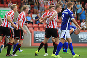 Kyle Storer celebrates his goal during the Vanarama National League match between Cheltenham Town and Barrow at Whaddon Road, Cheltenham, England on 22 August 2015. Photo by Antony Thompson.