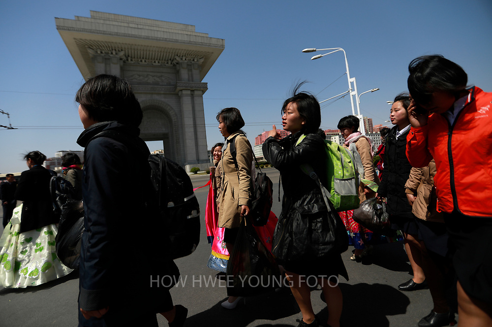 North Korean women walk past the Arc of Triumph after a rehearsal for 'Day of the Sun Festival' celebrations near the Kim Il Sung Stadium in Pyongyang, North Korea, 12 April 2017. North Koreans prepare to celebrate the 'Day of the Sun Festival', 105th birthday anniversary of former North Korean supreme leader Kim Il-sung in Pyongyang on 15 April.