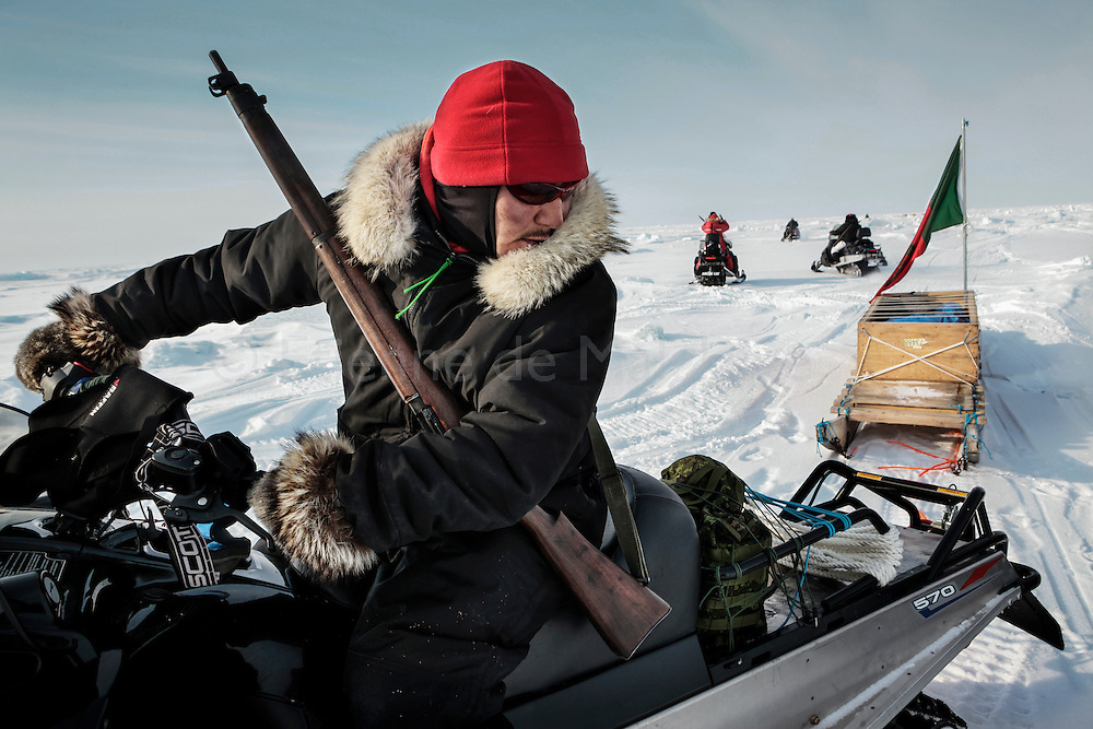 Canadian Rangers patrol rides snowmobiles for a shooting drill next to their camp in Baring Bay on Devon Island, Nunavut, during Nunalivut 2012 sovereignty exercise in arctic Canada. 20 April 2012. At this time they were equipped with museum-worthy WW2 Lee Enfield rifles that were later replaced with more modern weaponry. But as shown, uniform regulations are pretty laxly enforced as Inuits Rangers wisely complement army issued clothings with seculars furs and animal skins, still unmatched by synthetic fibers.<br /> Rangers are non-combat, part-time reserve auxiliaries that mix local volunteers, here Inuits, and professional military acting as eyes and ears in the most remote areas of northern Canada.