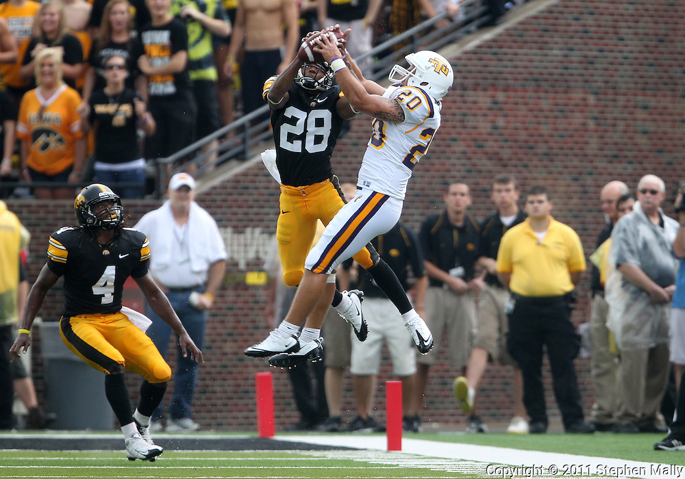 September 3, 2011: Iowa Hawkeyes defensive back Shaun Prater (28) pulls in a interception on a pass intended for Tennessee Tech Golden Eagles running back Doug Page (20) during the first half of the game between the Tennessee Tech Golden Eagles and the Iowa Hawkeyes at Kinnick Stadium in Iowa City, Iowa on Saturday, September 3, 2011. Iowa defeated Tennessee Tech 34-7 in a game stopped at one point due to lightning and rain.