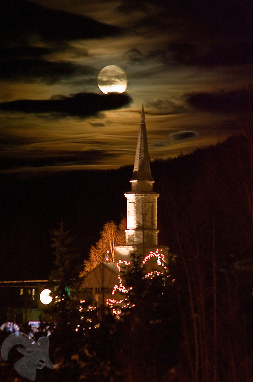 Holiday lights, artificial light and a full moon, illuminate the Eagle River Baptist Church in Eagle River, Alaska.