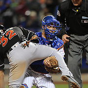 NEW YORK, NEW YORK - APRIL 12: Catcher Travis d'Arnaud, New York Mets, tags out Derek Dietrich, Miami Marlins at home plate during the Miami Marlins Vs New York Mets MLB regular season ball game at Citi Field on April 12, 2016 in New York City. (Photo by Tim Clayton/Corbis via Getty Images)