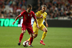 March 22, 2019 - Lisbon, Portugal - Portugal's midfielder Joao Moutinho (L) vies with Ukraine's midfielder Marlos during the UEFA EURO 2020 group B qualifying football match Portugal vs Ukraine, at the Luz Stadium in Lisbon, Portugal, on March 22, 2019. (Credit Image: © Pedro Fiuza/ZUMA Wire)