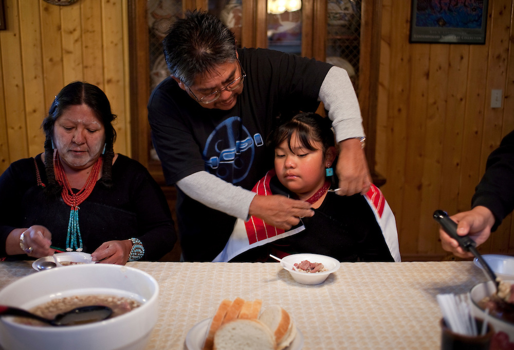 "After being up all night for Hotevilla's Basket Dance, Sarah and her granddaughter, Serena Honanie eat hominy stew for breakfast.  The Basket Dance is an annual Hopi tradition celebrating the end of harvest.  ""Corn is very important, my family belongs to the corn clan, all the way back to our grandmothers, we belong to the corn and water.  When I was growing up, I grew up to corn,"" said Sarah Honanie."