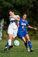 Milton's Kaleigh Goulette (4) and Rice's Margot Rathke (19) battle for the ball during the girls soccer game between the Milton Yellowjackets and the Rice Green Knights at Rice Memorial High School on Saturday afternoon October 3, 2015 in South Burlington. (BRIAN JENKINS/ for the FREE PRESS)