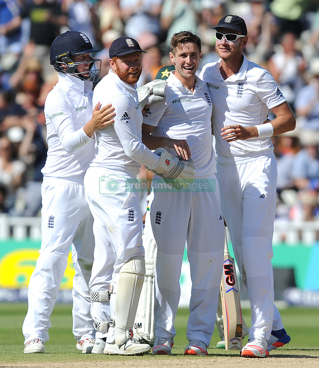 EnglandÕs Chris Woakes celebrates after trapping Pakistan's Asad Shafiq LBW with teammates Jonny Bairstow (left) and Stuart Broad during day five of the 3rd Investec Test Match at Edgbaston, Birmingham.
