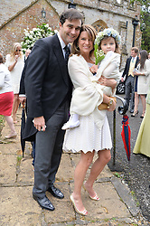 DAVID & GABRIELLA PEACOCK and their daughter at the wedding of Princess Florence von Preussen second daughter of Prince Nicholas von Preussen to the Hon.James Tollemache youngest son of the 5th Lord Tollemache held at the Church of St.Michael & All Angels, East Coker, Somerset on 10th May 2014.