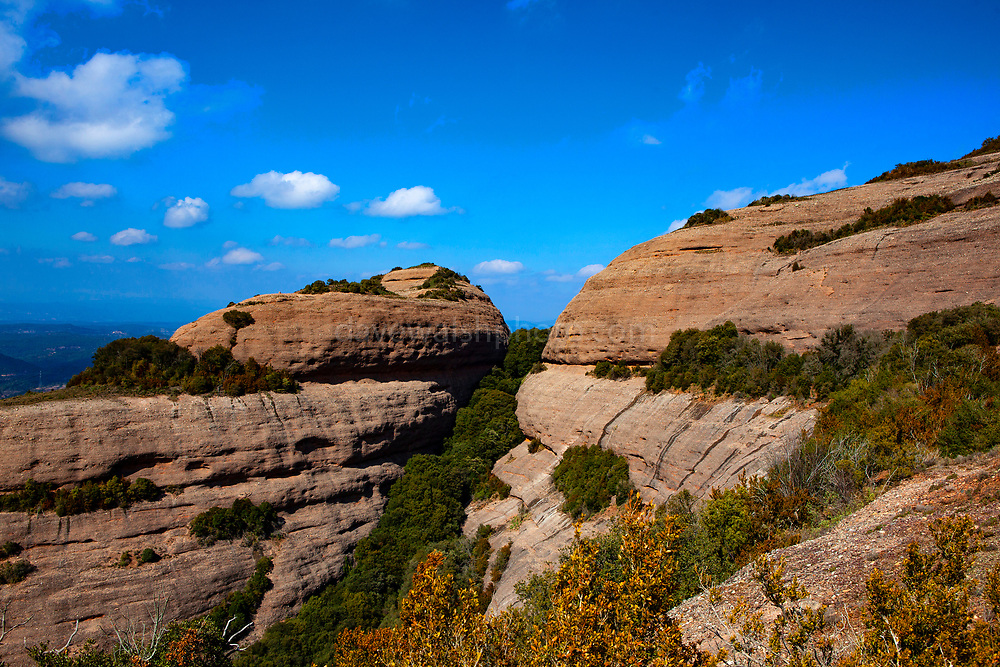 Rock formations on the the 1056 metre high mountain of Montcau, in the Parc Natural Sant Llorenc del Munt massif, near Barcelona, Catalonia.