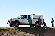 Border Patrol Agents and Patrol Vehicle at the  USA Mexico Border