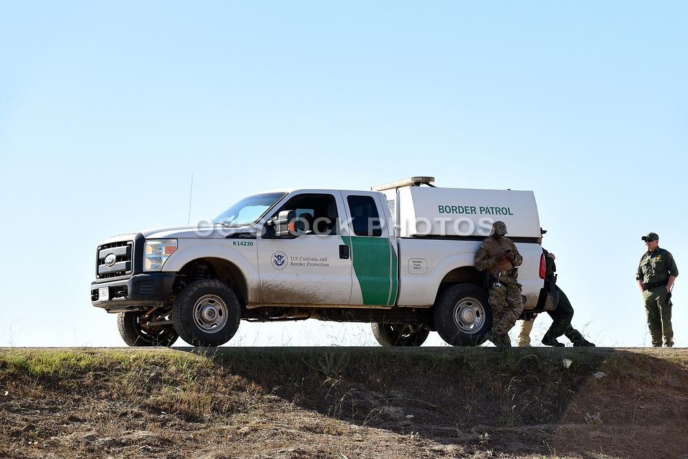 Border Patrol Agents and Patrol Vehicle at the  USA Mexico Border