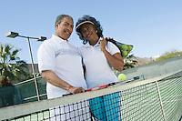 Couple at tennis court portrait