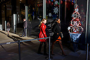 Women shoppers and mall decorations in the City of London.