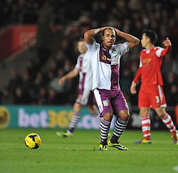 Aston Villa's Gabriel Agbonlahor puts his hands on his head as he can't believe offside flag has gone up. - Photo mandatory by-line: Alex James/JMP - Tel: Mobile: 07966 386802 04/12/2013 - SPORT - Football - Southampton - St Mary's Stadium - Southampton v Aston Villa - Barclays Premier League