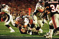 31 Jan 1999:  Quarterback John Elway #7 of the Denver Broncos goes over the line to score a touchdown during the fourth quarter of Super Bowl XXXIII between the Atlanta Falcons and the Denver Broncos at Pro Player stadium in Miami, Florida. Mandatory Credit: Tom Hauck/ALLSPORT