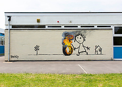 © Licensed to London News Pictures. 06/06/16. A general view of a recent artwork by graffiti artist Banksy on the side of Bridge Farm Primary school in Bristol. Photo credit should read Brad Wakefield/LNP