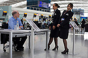 Heathrow writer-in-residence, Alain de Botton chats to British Airways staff while writing his airport novel in Terminal 5.