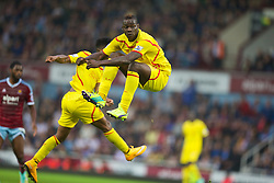 LONDON, ENGLAND - Saturday, September 20, 2014: Liverpool's Mario Balotelli gets out of the way as Raheem Sterling scores the first goal against West Ham United during the Premier League match at Upton Park. (Pic by David Rawcliffe/Propaganda)