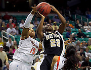 Virginia's Ariana Moorer (15) blocks Wake Forest's Lakevia Boykin shot during Wake's 74 - 68 win during the first round of the 2011 ACC Women's Basketball Tournament held at the Greensboro Coliseum in Greensboro, North Carolina.  (Photo by Mark W. Sutton)