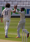 Ryan J Sidebottom (Yorkshire CCC) celebrates with team mate Adil U Rashid after taking the crunch wicket of Mark Stoneman  (Durham County Cricket Club) in the second innings  during the LV County Championship Div 1 match between Durham County Cricket Club and Yorkshire County Cricket Club at the Emirates Durham ICG Ground, Chester-le-Street, United Kingdom on 1 July 2015. Photo by George Ledger.
