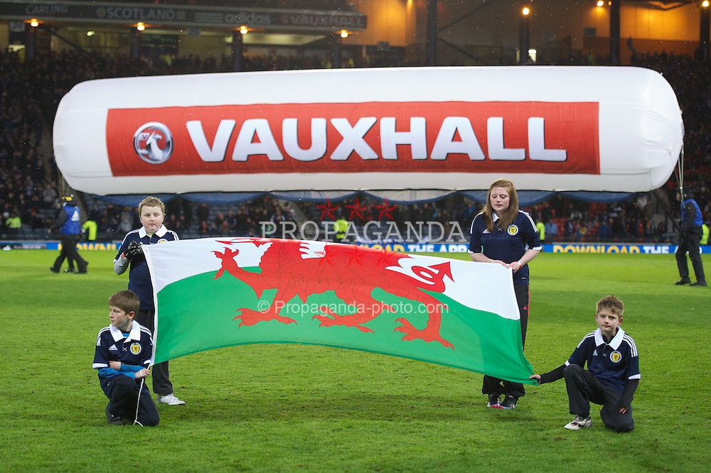 GLASGOW, SCOTLAND - Friday, March 22, 2013: Flag bearers with the Wales flag before the 2014 FIFA World Cup Brazil Qualifying Group A match against Scotland at Hampden Park. (Pic by David Rawcliffe/Propaganda)