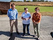 18 OCTOBER 2019 - CRAWFORDSVILLE, IOWA: ROYDON STROM, President and CEO of W2 Fuel, left, PATTY JUDGE, from Focus on Rural America, center, and US Senator AMY KLOBUCHAR (D-MN), during a tour of W2 Fuel, a biodiesel refinery that used soybeans to make biodiesel. W2 Fuel closed about a month ago because of low demand for biofuels, brought on by the number of biofuels waivers the US EPA has given to petroleum refineries. Sen. Klobuchar is on barnstorming bus tour of southeast Iowa this weekend. She is campaigning to be the Democratic nominee for the US Presidency. In addition to campaign meet and greet events, she stopped at a biofuels plant to learn about the difficulties farmers and biofuels producers face because of the trade war with China. Iowa holds the first selection event of the Presidential election cycle. The Iowa caucuses are Feb. 3, 2020.           PHOTO BY JACK KURTZ