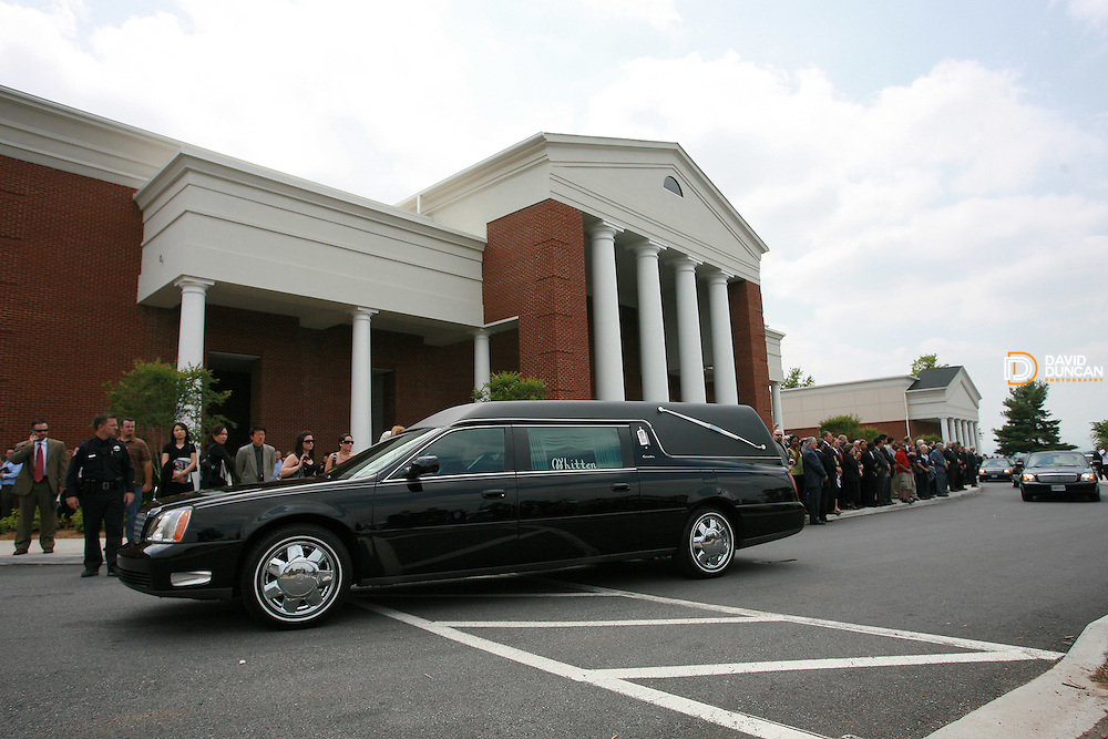 The hearse that is carrying the casket of the Rev. Jerry Falwell leaves the parking lot of Thomas Road Baptist Church Tuesday afternoon, May 22nd, 2007. About 10,000 mourners came to Lynchburg, VA to attend the services..Photo by David Duncan