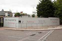 © Licensed to London News Pictures. 24/09/2012. London, UK. Image date 20/07/2012. Temporary hoarding outside the former News International site (Fortress Wapping) in Pennington Street, East London.  On 27 September 2012 the entire site contents will be sold at an online auction. The former News International site was sold to Berkeley Group's, St George in May 2012 who have renamed it 'London Dock' and are planning redevelopment as mixed residential, retail and office use. Photo credit : Vickie Flores/LNP