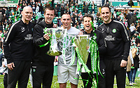 24/05/15 SCOTTISH PREMIERSHIP<br /> CELTIC v INVERNESS CT<br /> CELTIC PARK - GLASGOW<br /> (L-R) Stevie Woods, Ronny Deila, Scott Brown, John Collins and John Kennedy celebrate with the Scottish League Cup and the Scottish Premiership trophy<br /> ** ROTA IMAGE - FREE FOR USE **