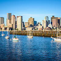 Boston skyline picture with Boston Harbor, downtown Boston skyscrapers, Port of Boston pier and sailboats.