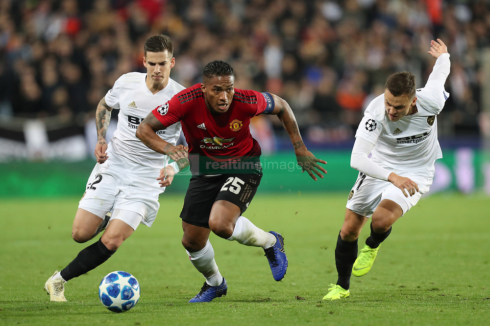 December 12, 2018 - Valencia, Spain - December 12, 2018 - Valencia, Spain - .Antonio Valencia of Manchester United evades Santi Mina and Denis Cheryshev of Valencia during the UEFA Champions League, Group H football match between Valencia CF and Manchester United on December 12, 2018 at Mestalla stadium in Valencia, Spain (Credit Image: © Manuel Blondeau via ZUMA Wire)