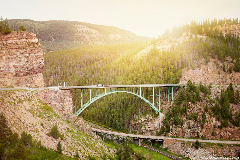 An Airstream RV trailer travels across the historic Red Cliff Bridge, aka Eagle River Bridge, on The Top of the Rockies scenic byway (US highway 24) in Colorado.