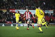 Brentford midfielder Sam Saunders driving forward to score the first goal of the game during the Sky Bet Championship match between Brentford and Leeds United at Griffin Park, London, England on 26 January 2016. Photo by Matthew Redman.