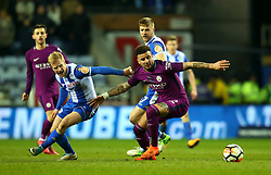 Kyle Walker of Manchester City goes past David Perkins of Wigan Athletic - Mandatory by-line: Robbie Stephenson/JMP - 19/02/2018 - FOOTBALL - DW Stadium - Wigan, England - Wigan Athletic v Manchester City - Emirates FA Cup fifth round proper