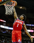 Dec 19, 2012; Houston, TX, USA; Philadelphia 76ers shooting guard Nick Young (1) dunks against the Houston Rockets during the second quarter at the Toyota Center. Mandatory Credit: Thomas Campbell-USA TODAY Sports