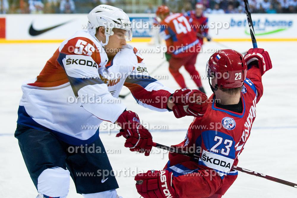 Robert Sabolic of Slovenia vs Alexei Tereshenko of Russia during ice-hockey match between Russia and Slovenia of Group A of IIHF 2011 World Championship Slovakia, on May 1, 2011 in Orange Arena, Bratislava, Slovakia. (Photo by Matic Klansek Velej / Sportida)
