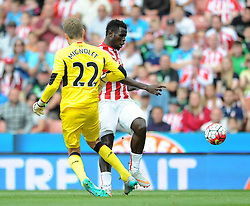 Mame Biram Diouf of Stoke City challenges Simon Mignolet of Liverpool - Mandatory byline: Dougie Allward/JMP - 07966386802 - 09/08/2015 - FOOTBALL - Britannia Stadium -Stoke-On-Trent,England - Stoke City v Liverpool - Barclays Premier League