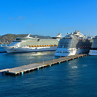 Three Cruise Ships Docked at Phillipsburg, Sint Maarten <br /> Over two million cruise ship passengers disembark annually to experience the beauty of St. Maarten/ St. Martin for a day.  So expect to see several vessels docked at Port St. Maarten when you arrive. The major terminal is in Philipsburg, the capital city of Sint Maarten, the Dutch side of the island.
