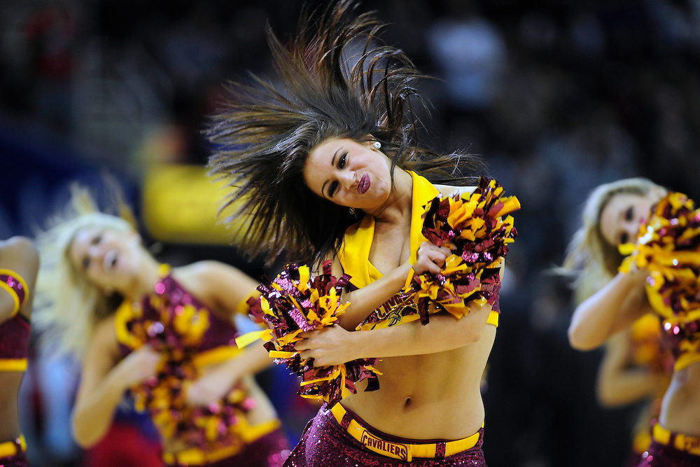 Feb. 11, 2011; Cleveland, OH, USA; A Cleveland Cavaliers cheerleader dances during the fourth quarter against the Los Angeles Clippers at Quicken Loans Arena. The Cavaliers broke their loosing streak beating the Clipper 126-119 in overtime. Mandatory Credit: Jason Miller-US PRESSWIRE