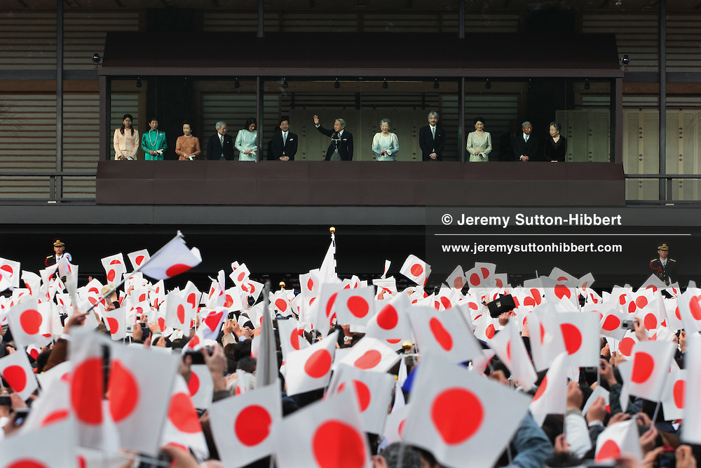 """The Japanese Imperial family appear on the balcony of the Imperial palace to greet the public below, to welcome the New Year of 2007, in Tokyo, Japan, on Tuesday, Jan. 2, 2007. The line up included Prince And Princess Hitachi, Emperor Akihito and Empress Michiko, Crown Prince Naruhito and his wife Crown Princess Masako, Prince Akishino and his wife Princess Kiko, Prince and Princess Mikasano. 40,000 well-wishers entered the East Palace Gardens to greet the Imperial family who appear on the Palace's Chowa-Den wing balcony. Accompanied by his siblings and his children and their wives the Emperor waved and said """"I wish for the happiness of people in our country and peace in the world"""". This appearance by the Imperial family is one of two opportunties the Japanese public have to greet them, the other being the Emperor's birthday 23rd, December."""