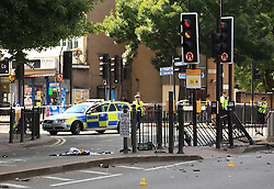 © Licensed to London News Pictures. 05/06/2014. London, UK. A crash scene in Poplar High Street, east London, as a  police car collided with a motorbike. Six people have been injured in a crash between a police car and a motorcycle in east London, the Met Police said. The crash happened near the junction of Cotton Street and Poplar High Street just before 13:25 BST. The 27-year-old motorcyclist has been taken to hospital with suspected head and leg injuries. Two officers in the car were also hurt but their injuries are not known, police said. Photo credit : LNP