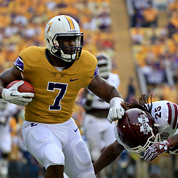 Sep 17, 2016; Baton Rouge, LA, USA;  LSU Tigers running back Leonard Fournette (7) is tackled by Mississippi State Bulldogs defensive back Lashard Durr (25) during the first quarter of a game at Tiger Stadium. Mandatory Credit: Derick E. Hingle-USA TODAY Sports