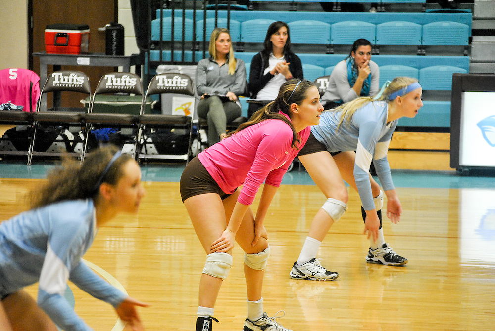 10/18/2013 - Cousens Gym, Tufts Medford campus - Tufts volleyball players  await the next play during the volleyball home game where Tufts defeats Hamilton 25-12. Caroline Geiling / The Tufts Daily